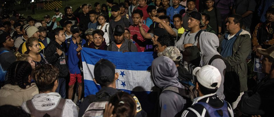 Hondurans gather to depart in a new caravan of migrants, set to head to the United States, in San Pedro Sula