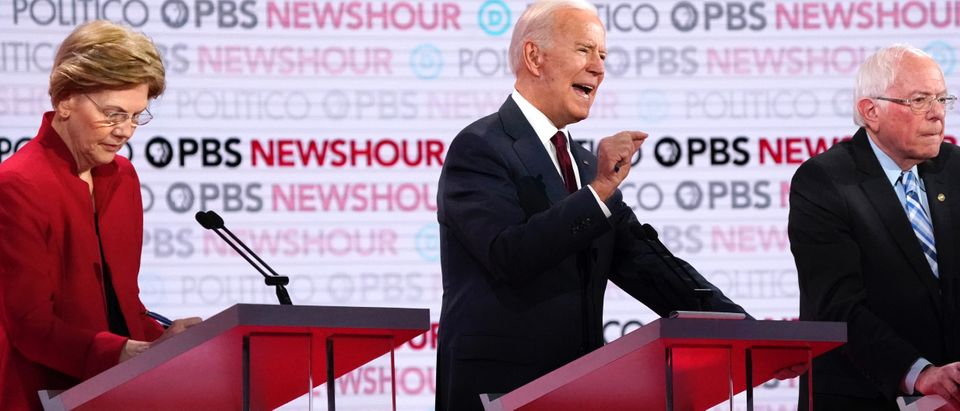 Democratic U.S. presidential candidates former Vice President Joe Biden speaks as Senator Elizabeth Warren and Senator Bernie Sanders listen at the 2020 campaign debate at Loyola Marymount University in Los Angeles