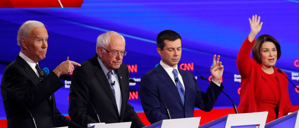 Democratic 2020 U.S. presidential candidates former Vice President Joe Biden, Sen. Bernie Sanders, former South Bend Mayor Pete Buttigieg and Sen. Amy Klobuchar participate in the seventh Democratic 2020 presidential debate at Drake University in Des Moines, Iowa, U.S., Jan. 14, 2020. REUTERS/Shannon Stapleton