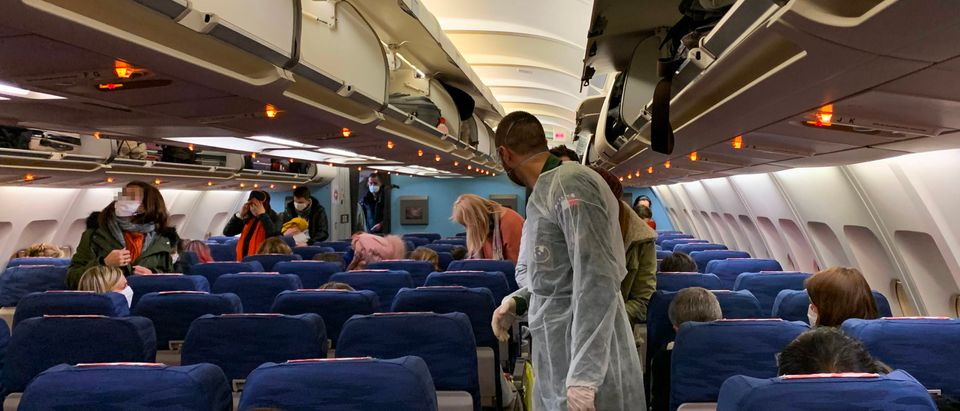French citizens arrive and settle aboard of an evacuation plane with destination southeastern France, before departure from Wuhan Airport (WUH), China, on the night between January 30, 2020 and January 31, 2020, as they are repatriated from the coronavirus hot zone.(Photo by HECTOR RETAMAL/AFP via Getty Images)