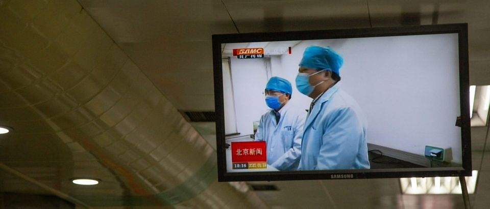 video featuring doctors in masks plays in a subway station on January 26, 2020 in Beijing, China. The number of cases of coronavirus rose to 1,975 in mainland China on Sunday. Authorities tightened restrictions on travel and tourism this weekend after putting Wuhan, the capital of Hubei province, under quarantine on Thursday. The spread of the virus corresponds with the first days of the Spring Festival, which is one of the biggest domestic travel weeks of the year in China. Popular tourism landmarks in Beijing including the Forbidden City, Badaling Great Wall, and The Palace Museum were closed to the public starting Saturday. The Beijing Municipal Education Commission announced it will delay reopening schools from kindergarten to university. The death toll on Sunday rose to 56. The majority of fatalities are in Wuhan where the first cases of the virus were reported last month. (Photo by Betsy Joles/Getty Images)
