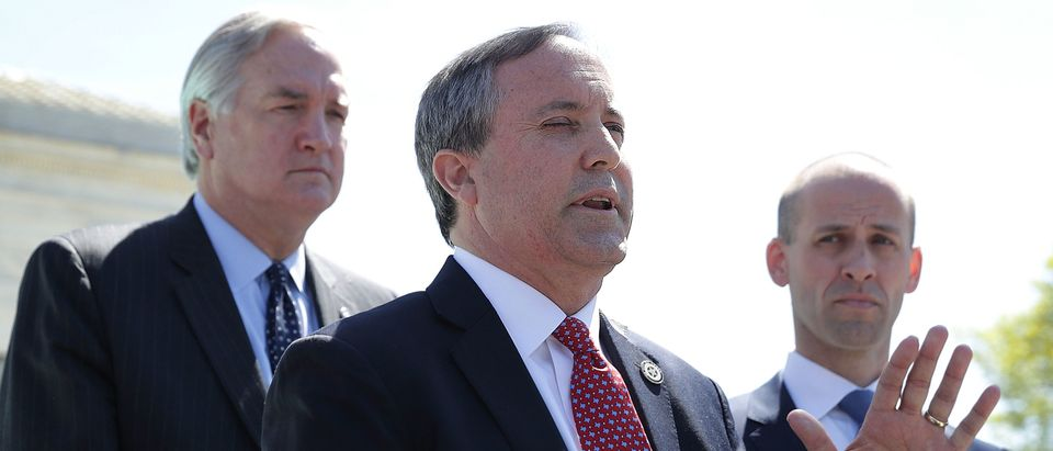 Texas Attorney General Kenneth Paxton (2nd R) speaks to members of the media as Texas Solicitor General Scott Keller (R) listens in front of the U.S. Supreme Court April 18, 2016 in Washington, DC. (Alex Wong/Getty Images)