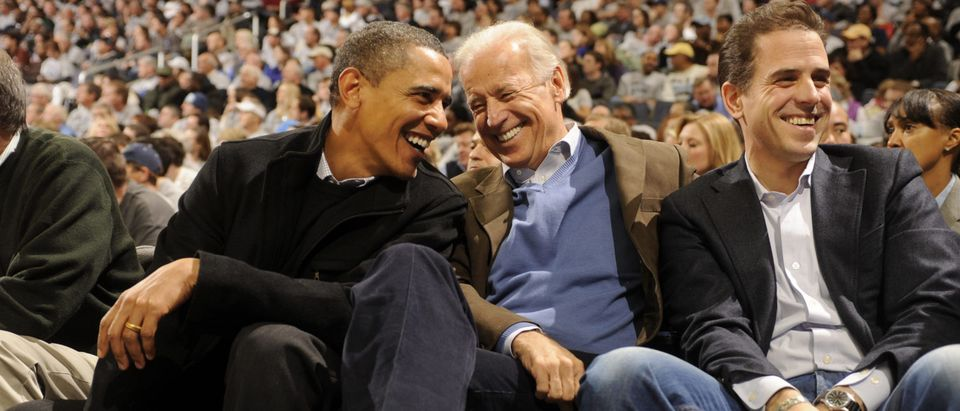 WASHINGTON - JANUARY 30: President of the United States Barack Obama and Vice President Joe Biden and Hunter Biden (son of Joe Biden) talk during a college basketball game between Georgetown Hoyas and the Duke Blue Devils on January 30, 2010 at the Verizon Center in Washington DC. (Photo by Mitchell Layton/Getty Images)