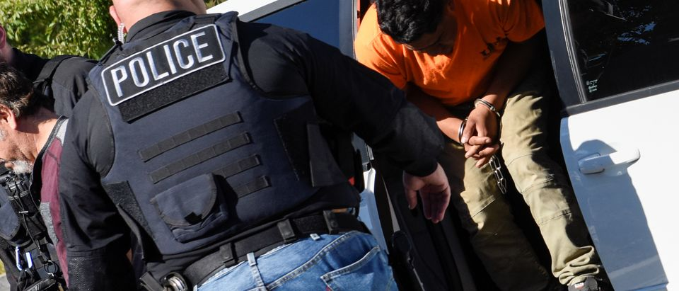 ICE Enforcement and Removal Operations (ERO) officers transfer an unauthorized immigrant with a criminal record during an Immigration and Customs Enforcement (ICE) operation in San Jose