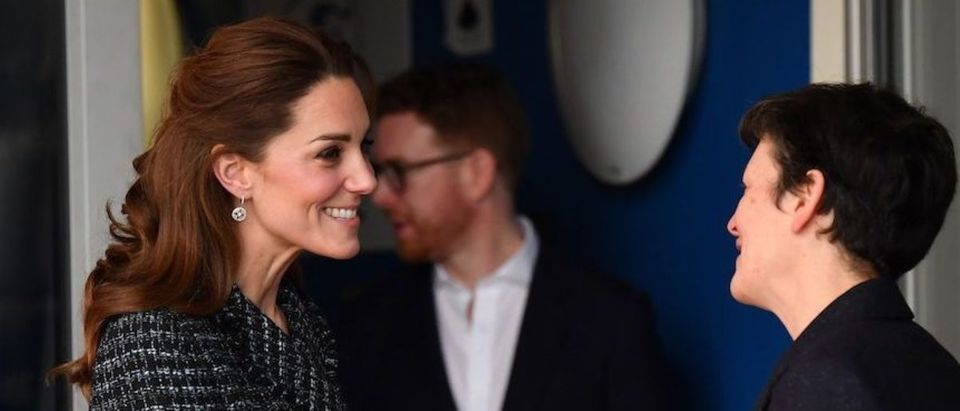 Britain's Catherine, Duchess of Cambridge (L) is accompanied by National Portrait Gallery Director Nicholas Cullinan (2L) as she leaves after a visit to the Evelina London Childrens Hospital in London on January 28, 2020 to join a creative workshop run by the National Portrait Gallerys Hospital Programme.(Photo by BEN STANSALL/AFP via Getty Images)