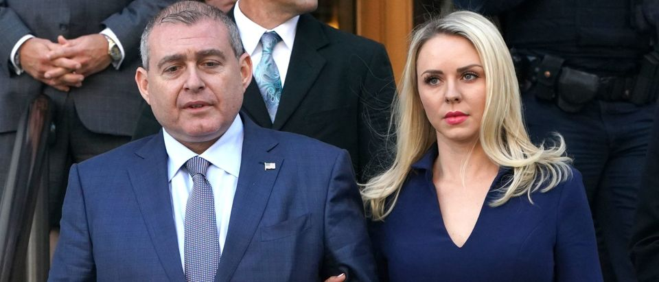 Lev Parnas, a Ukrainian-Floridian businessman who is both a client and associate of Rudy Giuliani, leaves with his wife Svetlana Parnas after his arraignment in the Southern District of New York court on October 23, 2019. - Parnas was arrested for campaign finance violations along with fellow businessman Igor Fruman in Virginia. Both Parnas and Fruman are being held on a million dollars bond and have been served with subpoenas to testify as a part of the impeachment investigation conducted by the US House of Representatives. (Photo by TIMOTHY A. CLARY/AFP via Getty Images)