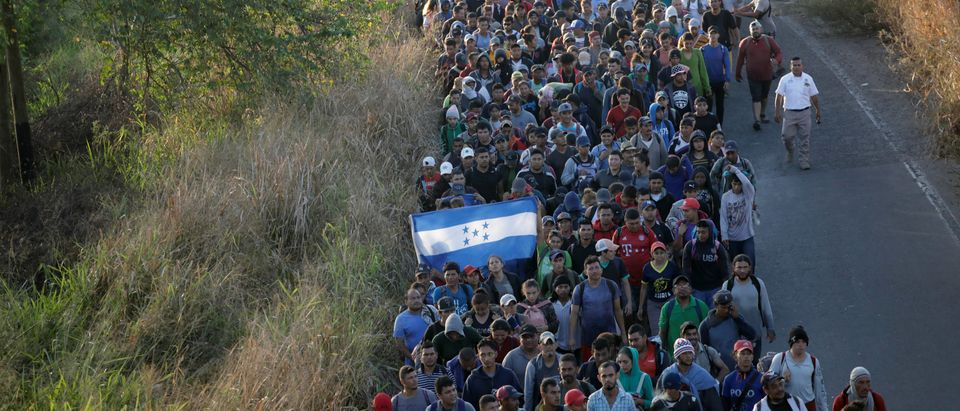 Migrants, mainly from Central America and marching in a caravan, walk on a road near Ignacio Zaragoza, Chiapas
