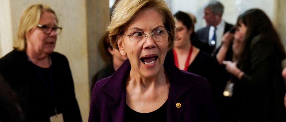 Senator Elizabeth Warren (D-MA) speaks to the media as the impeachment trial of U.S. President Donald Trump continues in Washington, U.S., January 27, 2020. REUTERS/Joshua Roberts -