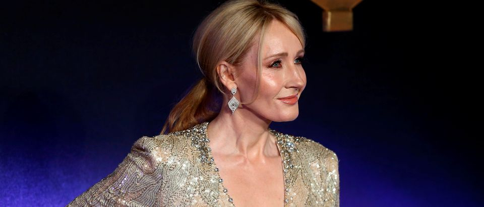 "Writer J.K. Rowling poses as she arrives for the European premiere of the film ""Fantastic Beasts and Where to Find Them"" at Cineworld Imax, Leicester Square in London"