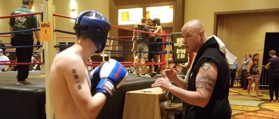 Metro Krav Maga and Kick-Boxing dojo Master Tom Whitaker gives his son Jimmy Whitaker a few pointers. Facebook/Metro Krav Maga and Kick-Boxing