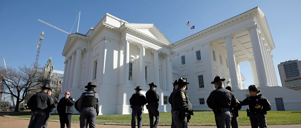 Police officers stand guard outside the Virginia State Capitol building as the General Assembly prepares to convene in Richmond, Virginia, U.S., Jan. 8, 2020. REUTERS/Jonathan Drake