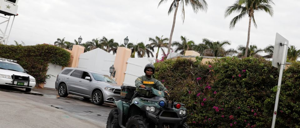 A police officer secures the entrance to U.S. President Donald Trump's Mar-a-Lago estate in Palm Beach, Florida, U.S., March 31, 2018. REUTERS/Yuri Gripas