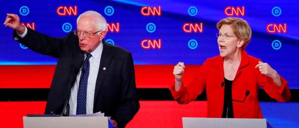 U.S. Senator Bernie Sanders and U.S. Senator Elizabeth Warren speak on the first night of the second 2020 Democratic U.S. presidential debate in Detroit, Michigan, U.S., July 30, 2019. REUTERS/Lucas Jackson
