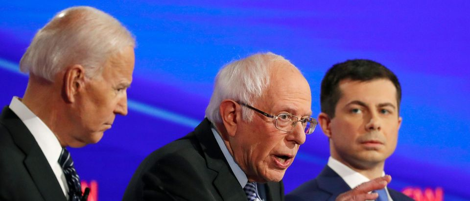 Democratic 2020 U.S. presidential candidates (L-R) former Vice President Joe Biden listens to Sen. Bernie Sanders as former South Bend Mayor Pete Buttigieg looks on in the seventh Democratic 2020 presidential debate at Drake University in Des Moines, Iowa, U.S., Jan. 14, 2020. REUTERS/Shannon Stapleton