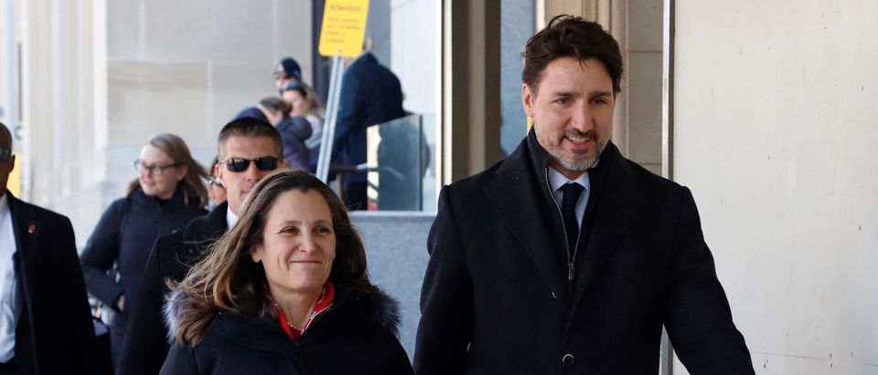 Canada's Prime Minister Justin Trudeau and Deputy Prime Minister Chrystia Freeland arrive to speak to news media in Ottawa