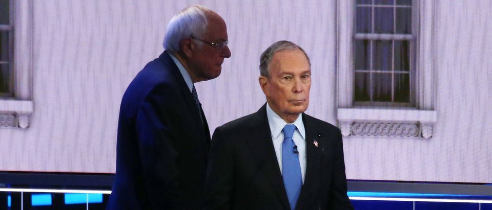 LAS VEGAS, NEVADA - FEBRUARY 19: Democratic presidential candidates Sen. Bernie Sanders (I-VT) (L) and former New York City mayor Mike Bloomberg take a break during the Democratic presidential primary debate at Paris Las Vegas on February 19, 2020 in Las Vegas, Nevada. Six candidates qualified for the third Democratic presidential primary debate of 2020, which comes just days before the Nevada caucuses on February 22. (Photo by Mario Tama/Getty Images)