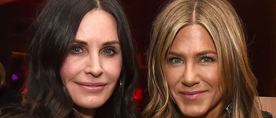 """Courteney Cox (L) and Jennifer Aniston pose at the after party for the premiere of Netflix's """"Dumplin'"""" at Sunset Tower on December 6, 2018 in Los Angeles, California. (Photo by Kevin Winter/Getty Images)"""