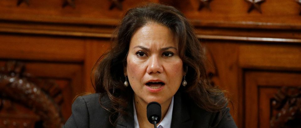 Rep. Veronica Escobar, D-Texas, votes no on the first article of impeachment against President Donald Trump on Capitol Hill, in Washington