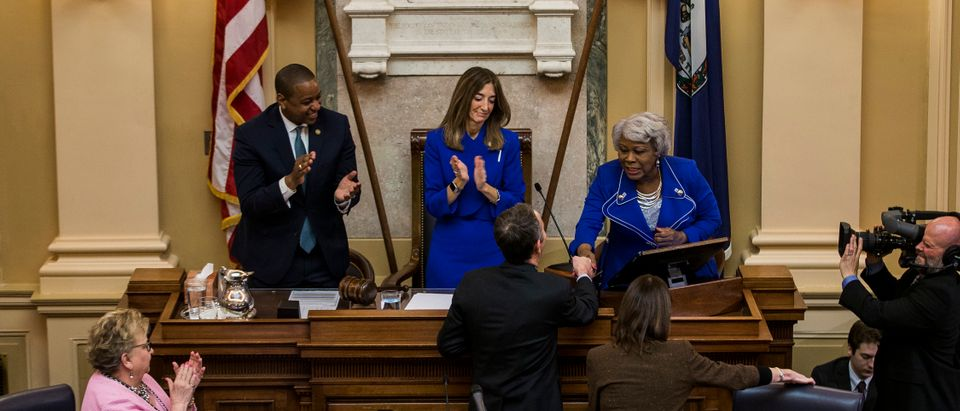 Senate President Pro Tempore Louise Lucas shakes hands with Gov. Ralph Northam as Lt. Gov. Justin Fairfax and House of Delegates Speaker Eileen Filler-Corn look on following the State of the Commonwealth address at the Virginia State Capitol on Jan. 8, 2020 in Richmond, Virginia. (Photo by Zach Gibson/Getty Images)