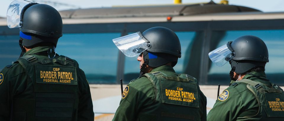 U.S. Customs and Border Protection agents participate in a training exercise at a vehicle entry point along the border with Mexico on Nov. 5, 2018, in Hidalgo, Texas. (ANDREW CULLEN/AFP via Getty Images)