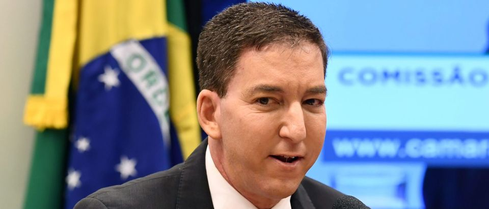 US journalist Glenn Greenwald, founder and editor of The Intercept website gestures during a hearing at the Lower House's Human Rights Commission in Brasilia, Brazil, on June 25, 2019. (EVARISTO SA/AFP via Getty Images)