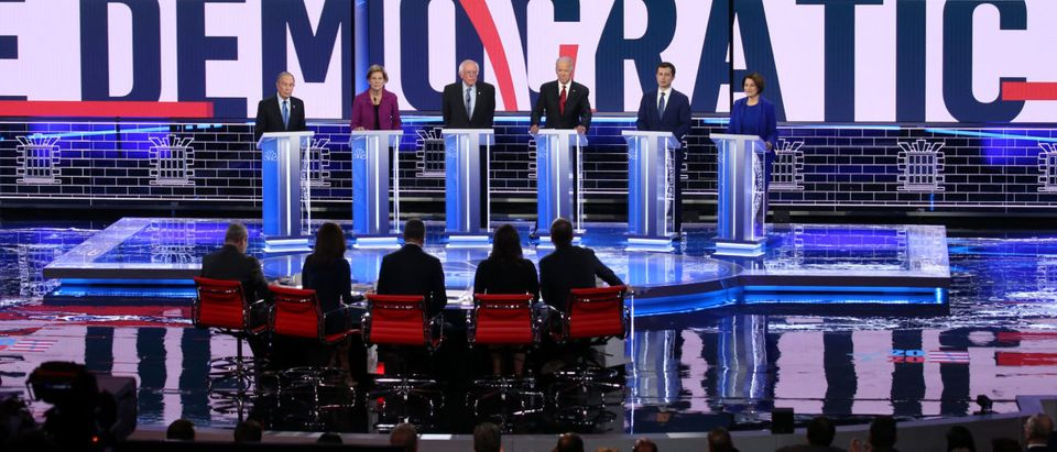Democratic presidential candidates (L-R) former New York City Mayor Mike Bloomberg, Sen. Elizabeth Warren, Sen. Bernie Sanders, former Vice President Joe Biden, former South Bend, Indiana, Mayor Pete Buttigieg and Sen. Amy Klobuchar (R) participate in the Democratic presidential primary debate at Paris Las Vegas on Feb. 19, 2020 in Las Vegas, Nevada. (Photo by Mario Tama/Getty Images)
