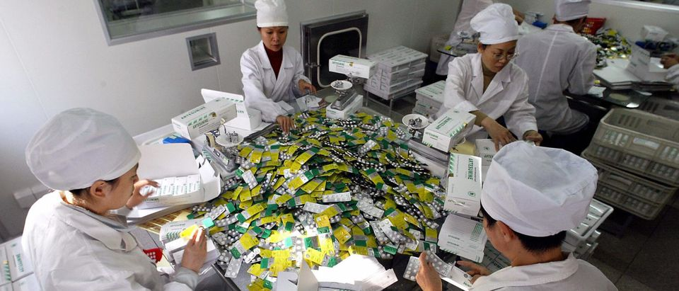 Workers package pills at Guilin Pharmace