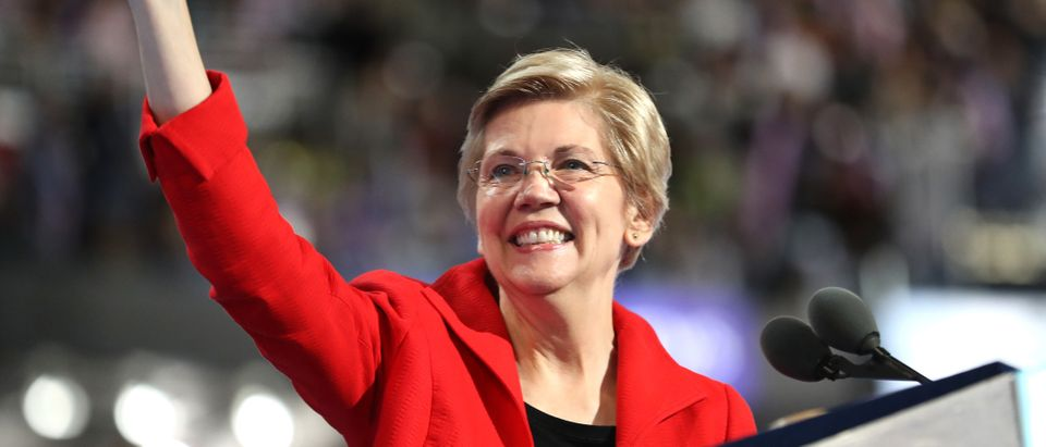 Sen. Elizabeth Warren acknowledges the crowd as she walks on stage to deliver remarks on the first day of the Democratic National Convention at the Wells Fargo Center, July 25, 2016 in Philadelphia, Pennsylvania. (Photo by Joe Raedle/Getty Images)