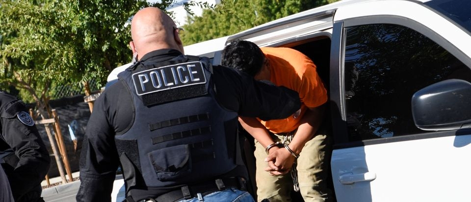 ICE Enforcement and Removal Operations (ERO) officers transfer an unauthorized immigrant with a criminal record during an Immigration and Customs Enforcement (ICE) operation in San Jose, California, Sept. 25, 2019. REUTERS/Kate Munsch