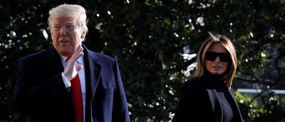 U.S. President Donald Trump with First Lady Melania Trump response to questions from the media on the South Lawn of the White House in Washington, U.S., before their departure to India, February 23, 2020. REUTERS/Yuri Gripas