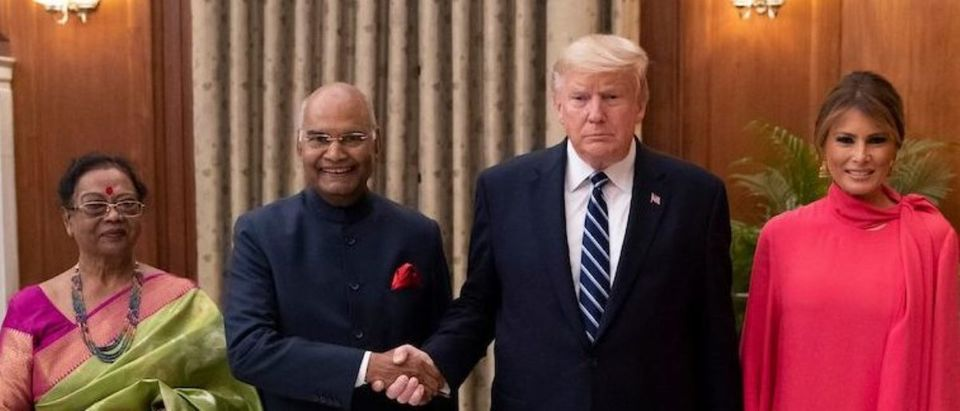 US President Donald Trump and First Lady Melania Trump pose with India's President Ram Nath Kovind and his wife Savita Kovind during a state banquet at Rashtrapati Bhavan - The Presidential Palace in New Delhi on February 25, 2020. (Photo by ALEX BRANDON/POOL/AFP via Getty Images)