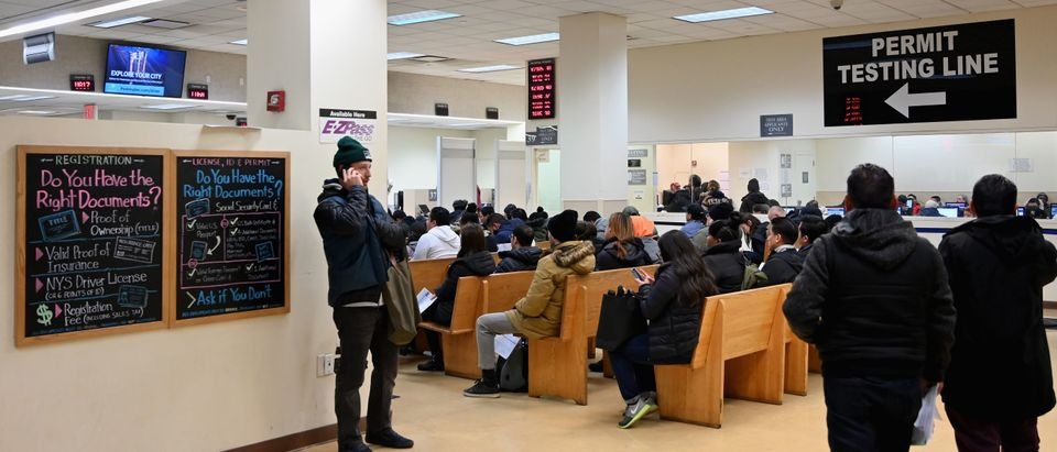 People wait at the New York State Department of Motor Vehicles (DMV) office at Atlantic Center in the Brooklyn borough of New York on Dec. 18, 2019. (Photo by ANGELA WEISS/AFP via Getty Images)