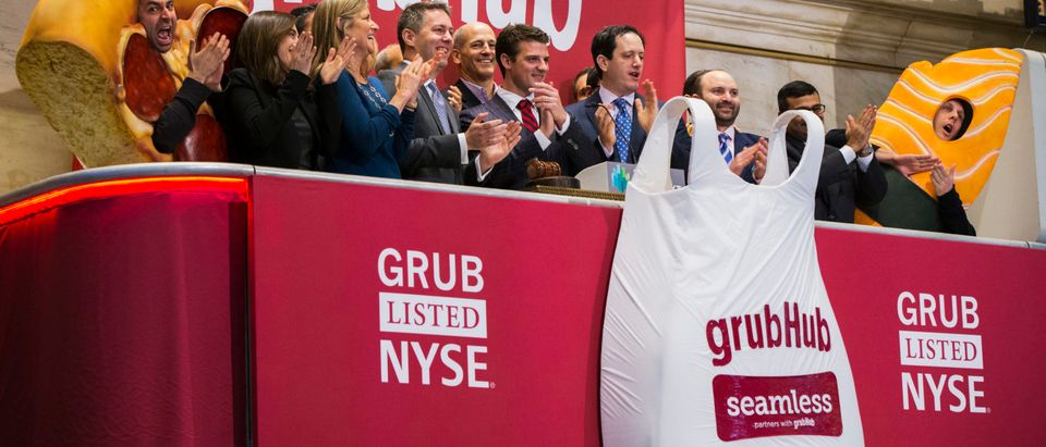 GrubHub CEO Matt Maloney applauds after ringing the opening bell before the company's IPO on the floor of the New York Stock Exchange in New York