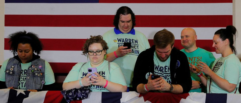 Supporters of Democratic 2020 U.S. presidential candidate Warren look at their mobile phones in Des Moines