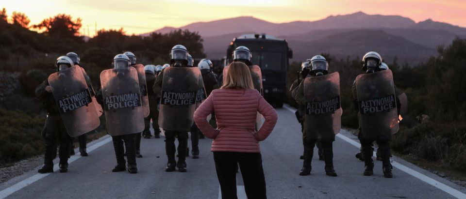 A Greek woman stands off with police. (Reuters/Elias Marcou)