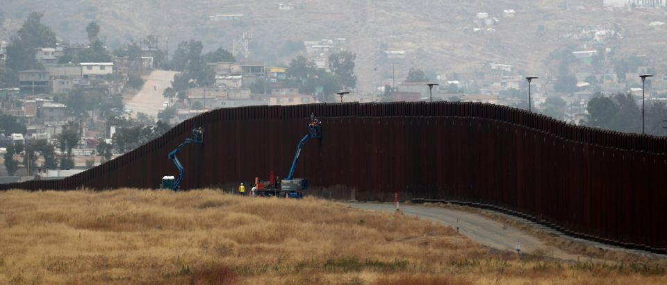 Workers weld sections of a newly replaced border wall with Tijuana, Mexico near the the Otay Mesa border crossing in San Diego, California, May 31, 2019. REUTERS/Mike Blake