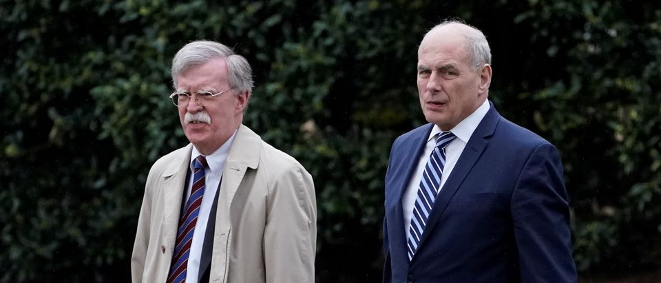 White House Chief of Staff John Kelly and new National Security Advisor John Bolton leave the Oval Office as U.S. President Donald Trump departs the White House for a trip to Miami, Florida, in Washington, D.C., U.S., April 16, 2018. REUTERS/Carlos Barria