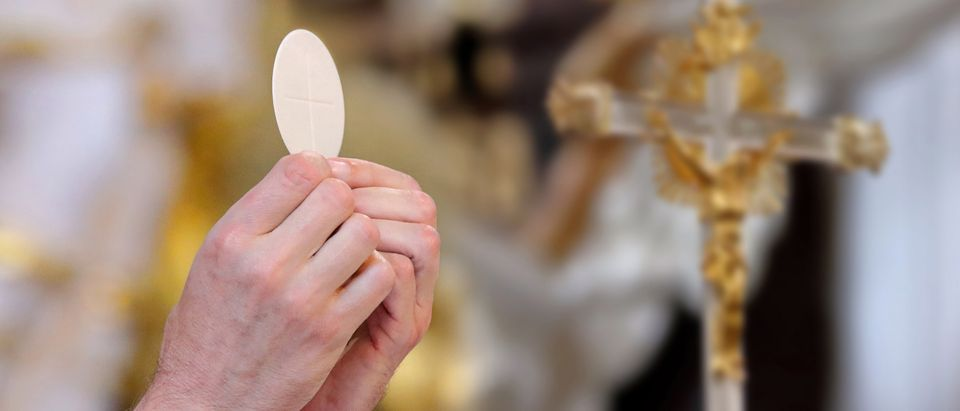 The pastor of a Rhode Island parish warned pro-abortion lawmakers not to attempt to receive Holy Communion at his parish and said their stances put them at odds with Catholic teaching. Wideonet, Shutterstock