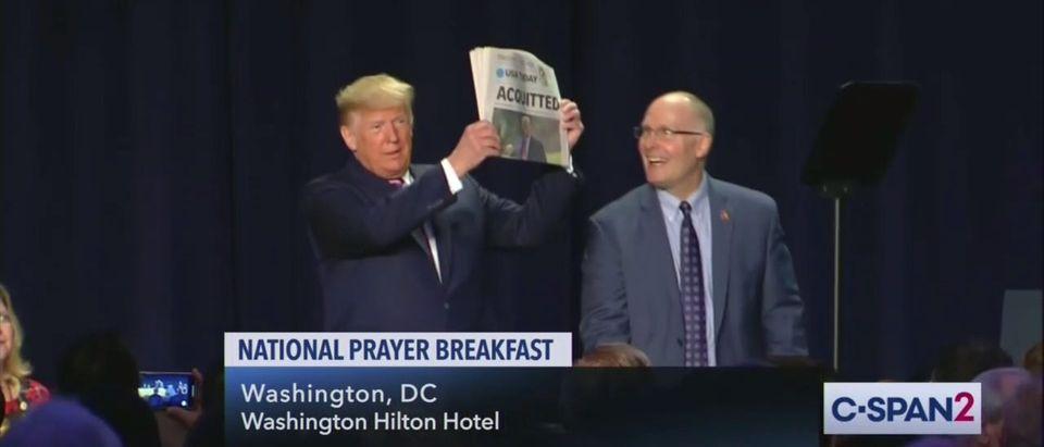 """Trump brandished an """"acquittal"""" newspaper during a speech. (Screenshot/Twitter/AaronRupar)"""