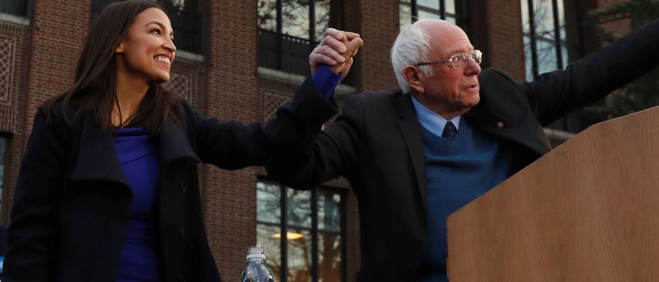 U.S. Rep. Ocasio-Cortez greets U.S. Democratic presidential candidate Sanders during a rally at the University of Michigan in Ann Arbor