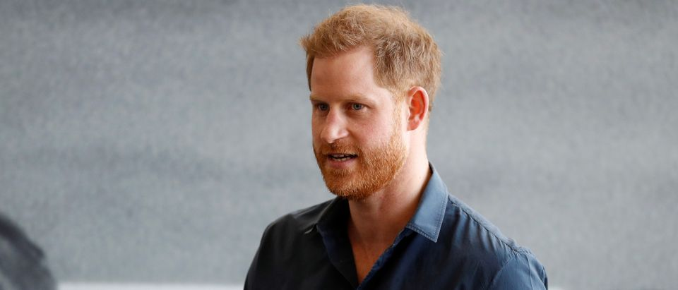 Britain's Prince Harry speaks during a visit to the Silverstone circuit in Towcester