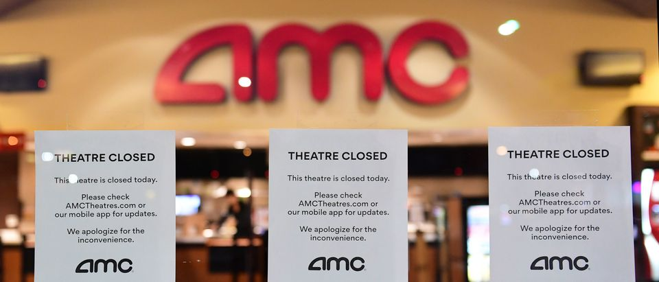 """Theater Closed"" signs are posted in front of the AMC Montebello, as the US chain of AMC movie theaters closes for 6 to 12 weeks, On March 17, 2020 in Montebello, California, as the coronavirus (covid-19) epidemic leads to restaurant and school closures and workers working from home in an effort to encourage social distancing. - The White House has suggested gatherings limited to 10 people or less as the number of coronavirus cases across the country passes 5,000 with 100 dead. (Photo by Frederic J. BROWN / AFP) (Photo by FREDERIC J. BROWN/AFP via Getty Images)"