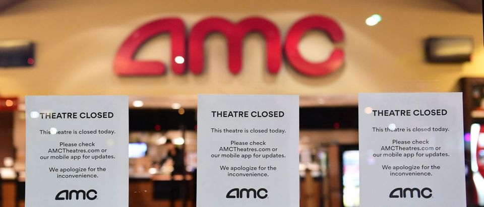 """Theater Closed"" signs are posted in front of the AMC Montebello, as the US chain of AMC movie theaters closes for 6 to 12 weeks, On March 17, 2020 in Montebello, California, as the coronavirus (covid-19) epidemic leads to restaurant and school closures and workers working from home in an effort to encourage social distancing. - The White House has suggested gatherings limited to 10 people or less as the number of coronavirus cases across the country passes 5,000 with 100 dead. (Photo by FREDERIC J. BROWN/AFP via Getty Images)"