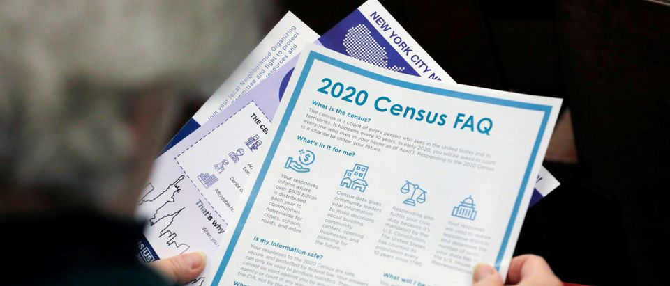 FILE PHOTO: A person holds census information at an event where U.S. Rep. Alexandria Ocasio-Cortez (D-NY) spoke at a Census Town Hall at the Louis Armstrong Middle School in Queens, New York City