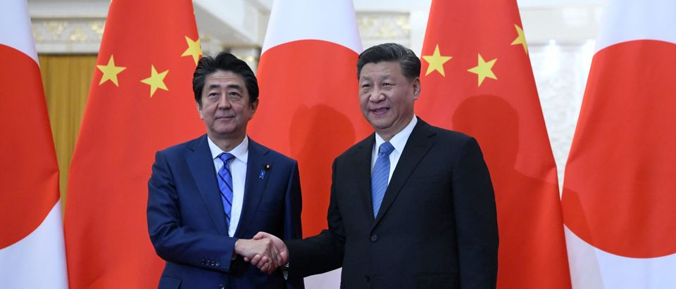 China's President Xi Jinping Meets Japan's Prime Minister Shinzo Abe