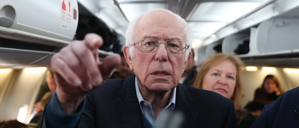 Democratic presidential candidate Sen. Bernie Sanders (I-VT) speaks to the media after boarding the plane at the Des Moines International Airport on February 04, 2020 in Des Moines, Iowa. (Joe Raedle/Getty Images)