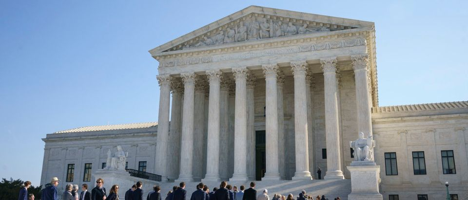 Members of the public wait in line outside the U.S. Supreme Court for a chance to hear oral arguments inside the court on March 2, 2020 in Washington, DC. (Drew Angerer/Getty Images)
