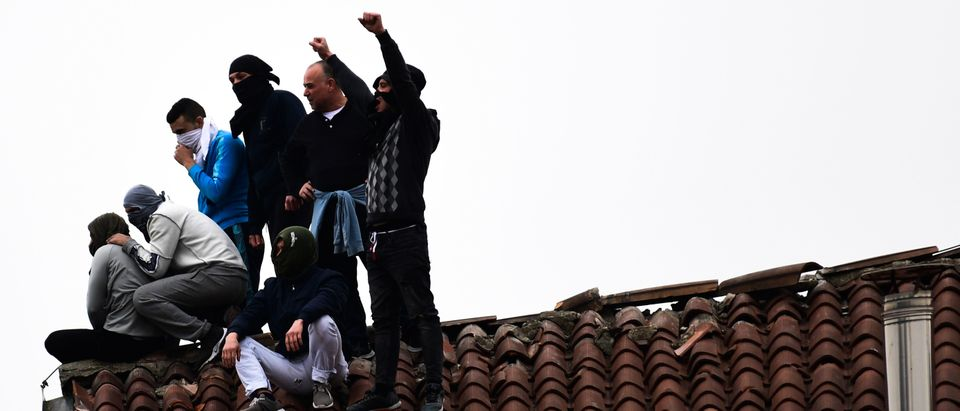 Inmates stage a protest on a rooftop of a wing at the San Vittore prison in Milan on March 9, 2020, in one of Italy's quarantine red zones. (MIGUEL MEDINA/AFP via Getty Images)