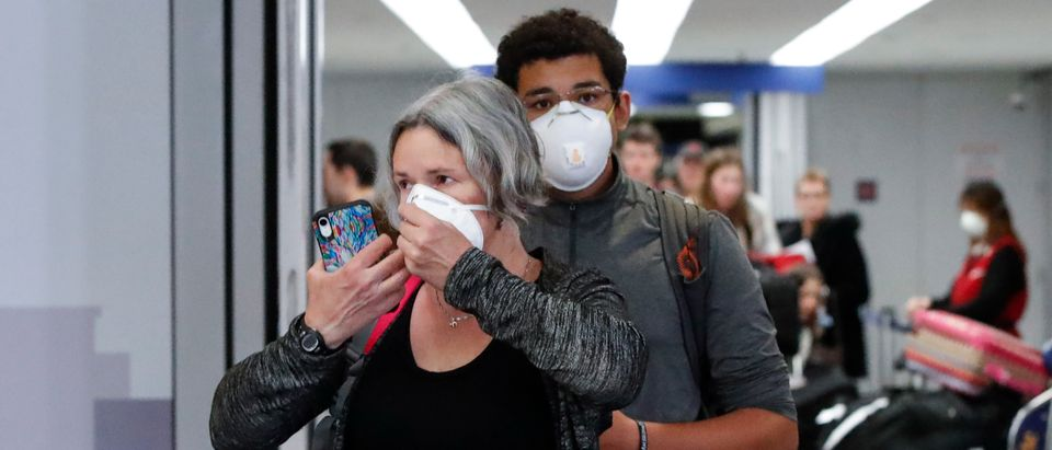 Travelers arrive at the international terminal of the O'Hare Airport in Chicago, Illinois, on March 15, 2020. (KAMIL KRZACZYNSKI/AFP via Getty Images)