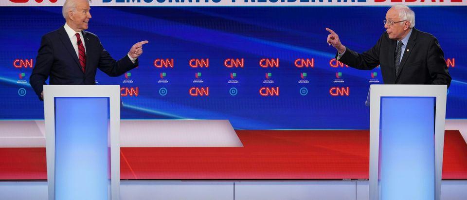 Democratic presidential hopefuls former US vice president Joe Biden (L) and Senator Bernie Sanders point fingers at each other as they take part in the 11th Democratic Party 2020 presidential debate in a CNN Washington Bureau studio in Washington, DC on March 15, 2020. (Photo by MANDEL NGAN/AFP via Getty Images)
